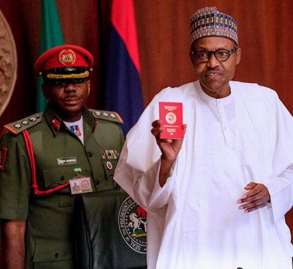 Photo of Buhari Launches a New Red Nigerian Passport with a 10 years Validity
